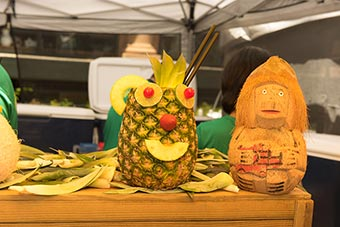 tropical drinks in hollowed out pineapple and coconut