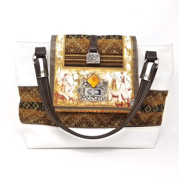 Victor and Yaneth Yurivilka leather purse adorned with silver and stone