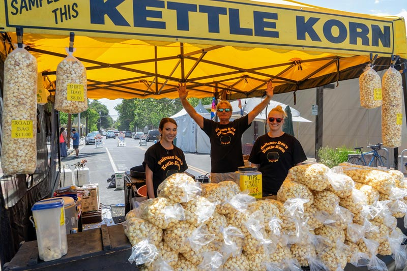 Suitcase Ron kettle korn booth is a festival favorite