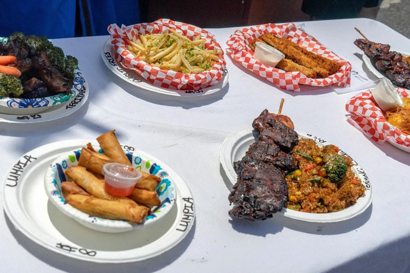 plates filled with international foods are festival favorites
